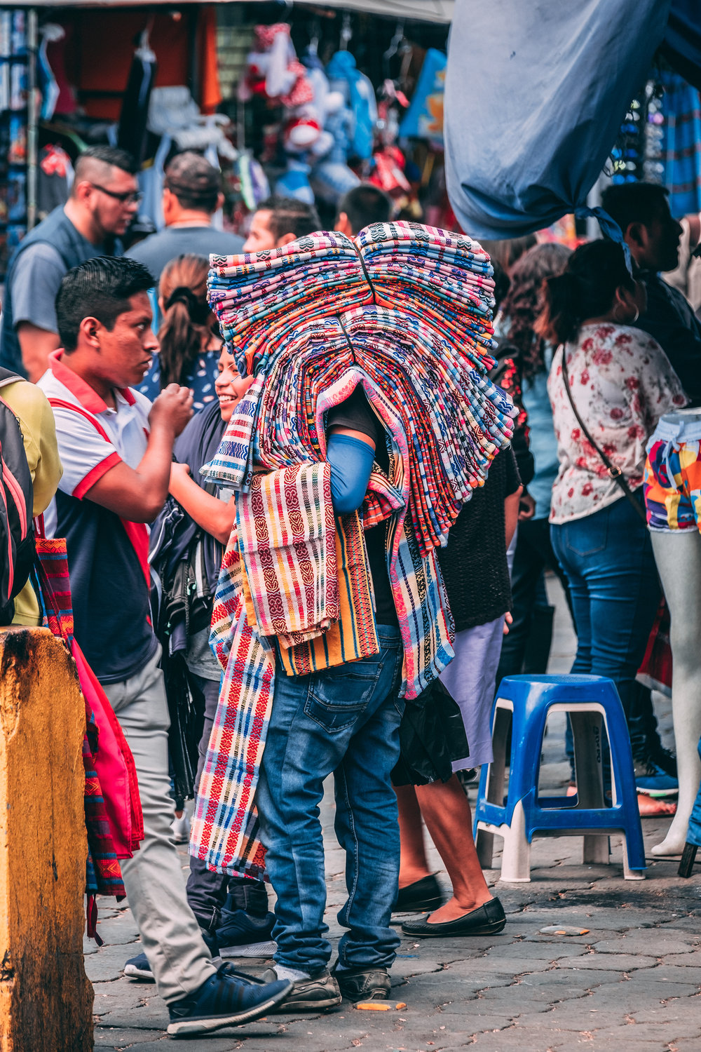 A blanket vendor ion the street in Antigua, Guatemala.