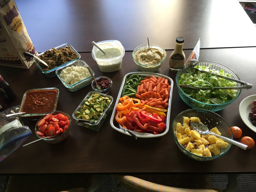 A delicious burrito and salad bar for one of our program dinners