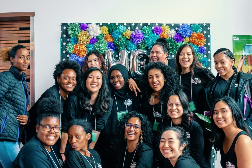 The 2018 Activistas, Adult Allies, and Powerful Voices staff posing in the photobooth at our youth-led, social justice Girlvolution Conference