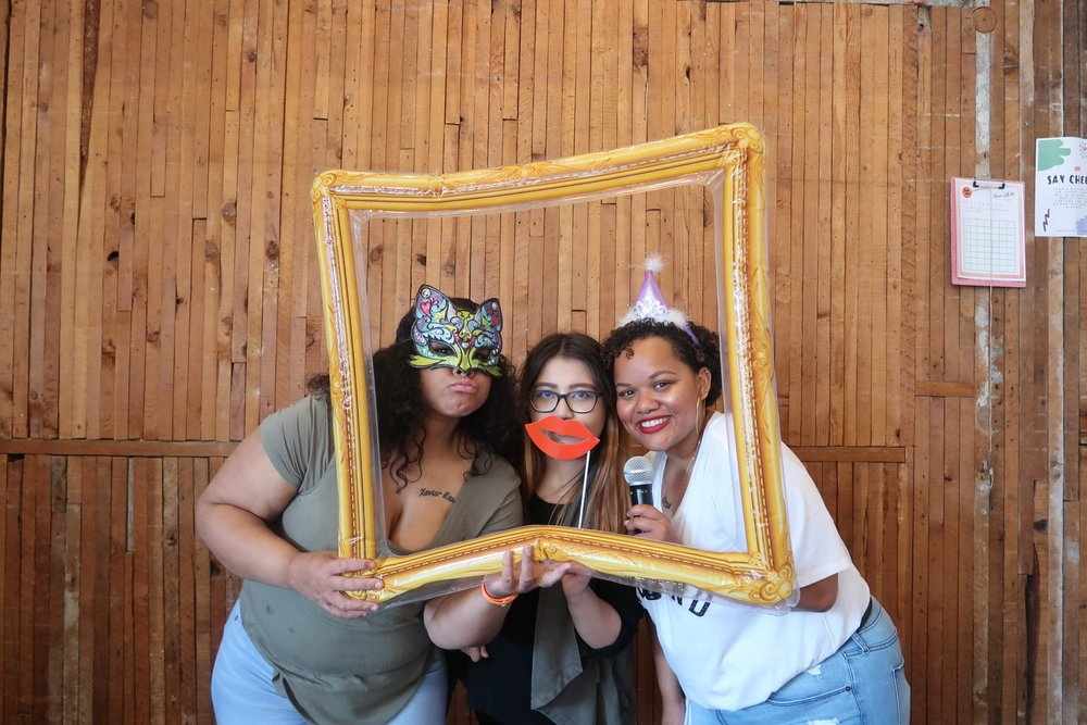 Two staff members and our 2017-2018 MSW Intern posing in a photobooth at our 23rd Birthday Party