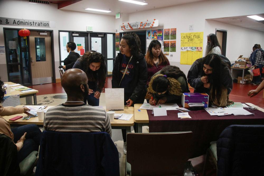 Board members volunteering at 2018 Girlvolution registration table
