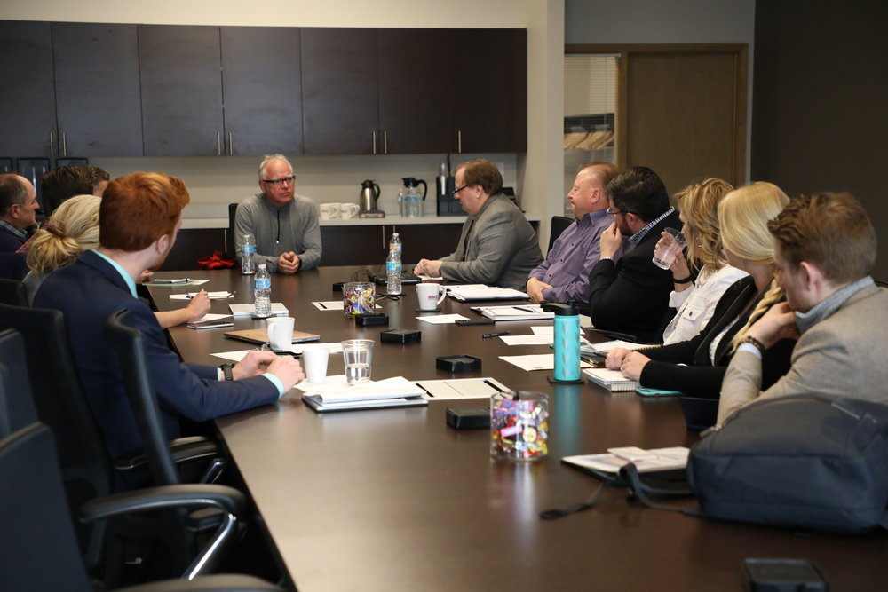 Congressman Tim Walz (CD-1, DFL), 2018 gubernatorial candidate, discusses housing issues with Housing First Minnesota leaders.