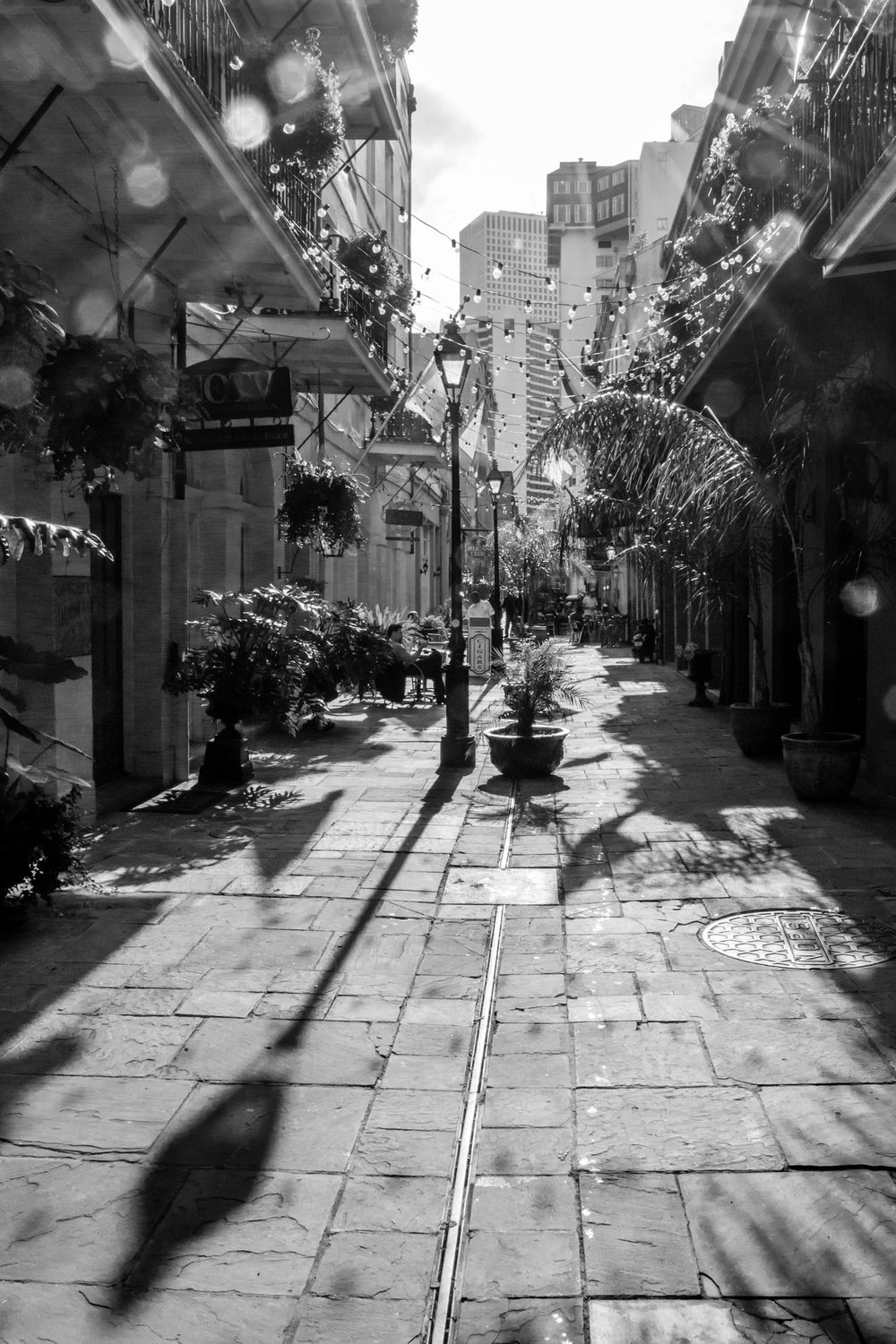 The lamp post's shadow takes the viewer into this alley in the French Quarter.