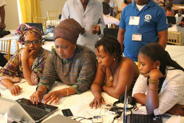 Participants learning hands-on how to create educational videos through an OMPT Video Education Workshop in Guinea
