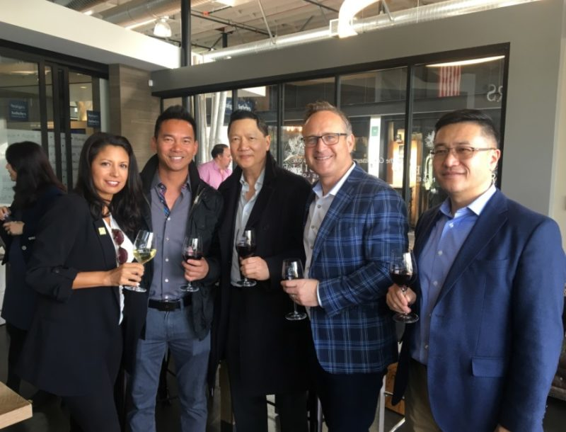Above: AREAA executives enjoy a glass of DeLille Cellars wine at the RSIR branch office in Kirkland following the presentations by Sotheby's International Realty speakers.