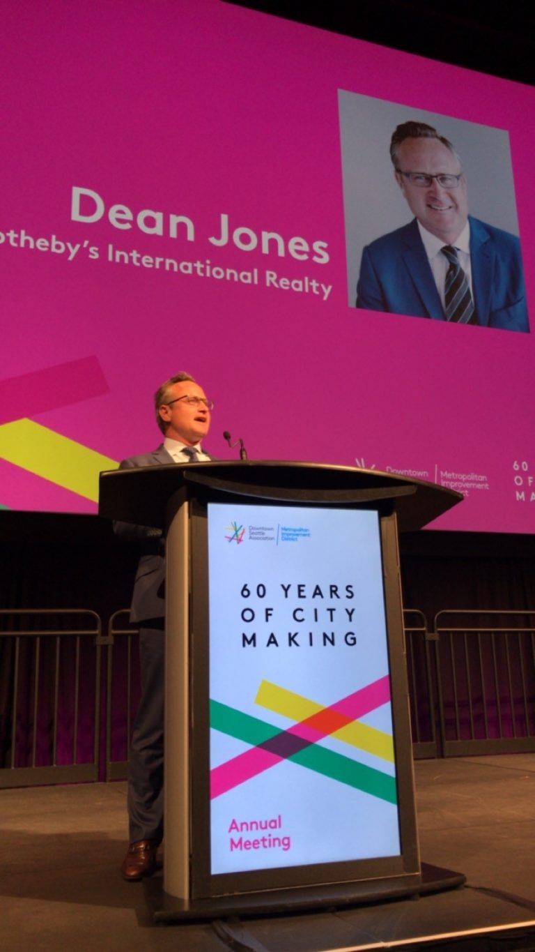"""Above: Jones was invited to give an opening address at the event, where he proclaimed a """"100% chance of condominiums"""" in Seattle."""