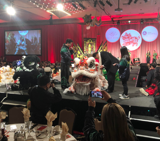PICTURED ABOVE AND BELOW:  Guests were treated to numerous productions and a live auction as they dined and sampled fine wines from Washington.