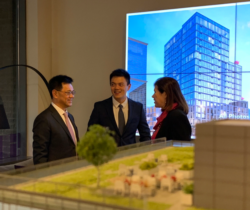 PICTURED ABOVE:    Da Li Development team members and invited guests enjoy a private preview of the KODA Sales Gallery ahead of its public debut.
