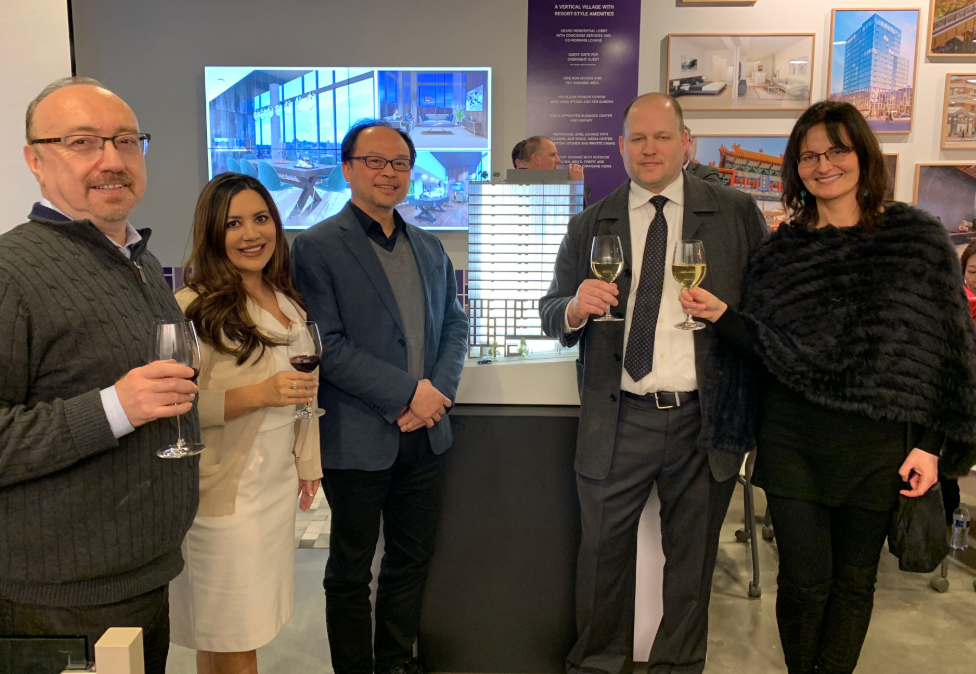 PICTURED ABOVE:    Members of KMD Architects raise a glass in celebration of receiving the final design approval for the new high-rise, which now moves forward to issuance of its Master Use Permit.