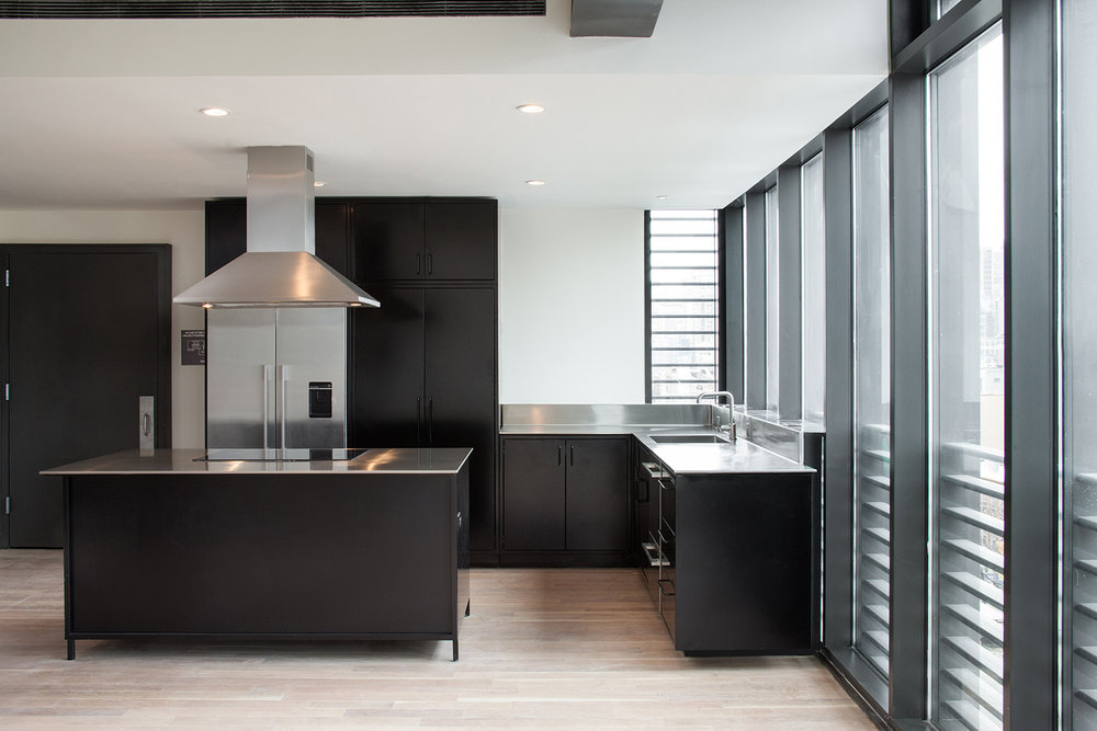 Brooklyn, New York -  - Loft kitchens: Modern simplicity Bentley blue steel cabinets- Overlay doors and drawers free of hinges