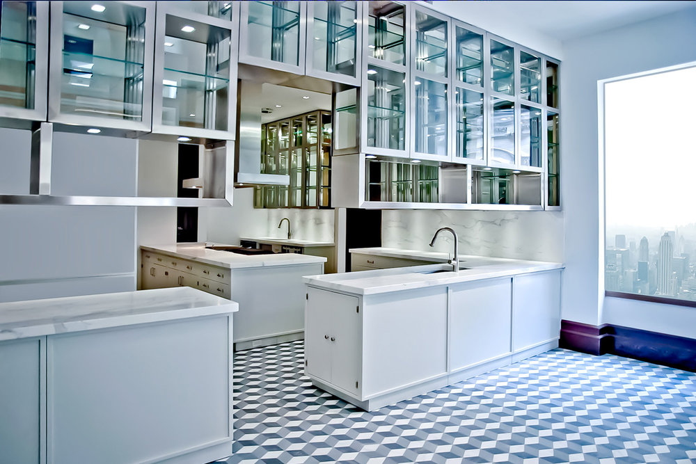 Manhattan, New York - -Kitchen: Iconic upper west side 1890's apartment-Classic white powder coated kitchen cabinets combined with custom engineered stainless steel plate cabinets.