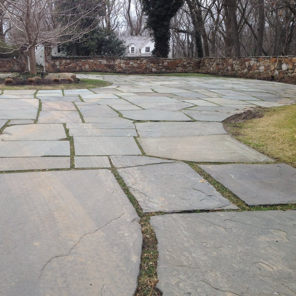 Following the installation of replacement flagstone, we poured compatible hydraulic lime mortar between the open joints – to prevent ice-jacking during the winter – and then finished the surface with a layer of grass seed and dirt, to better weave this historic driveway into the surrounding landscape.