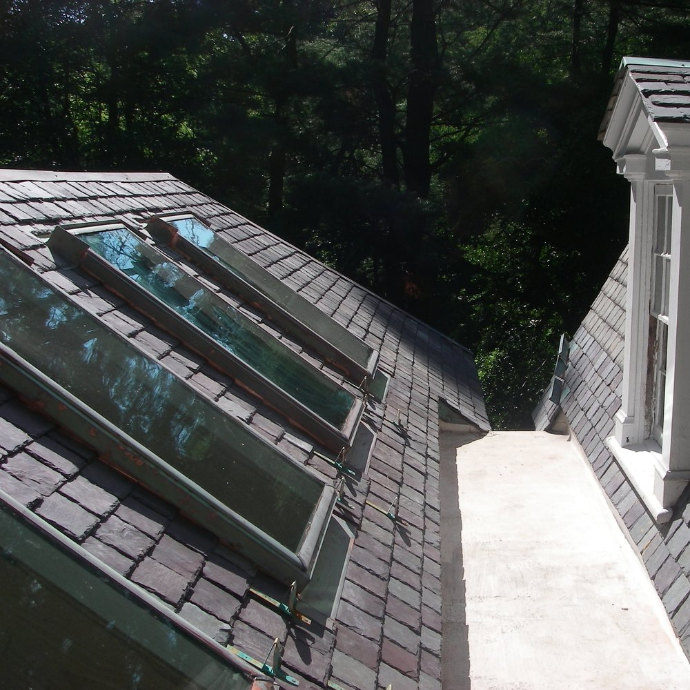 On the garden side of this colonial Mill Creek property, which fell under the purview of the Lower Merion Historical Commission, we installed the TPO flat roof membrane, slate, copper flashing / ridge, as well as these gorgeous copper-clad VELUX skylights – a custom design that we had to import from Denmark.