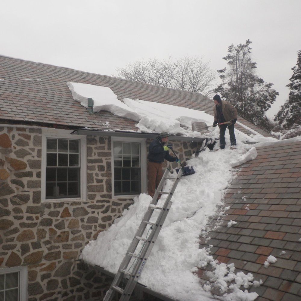 Emergency snow removal service for a customer affected by the historic blizzard of 2010. If snow guards had been installed along the starter courses, such drifts of heavy, wet snow probably would not have amassed, melted, and later refrozen over the once noble and now malformed gutters / fascia – especially on the upper roof, to the left.