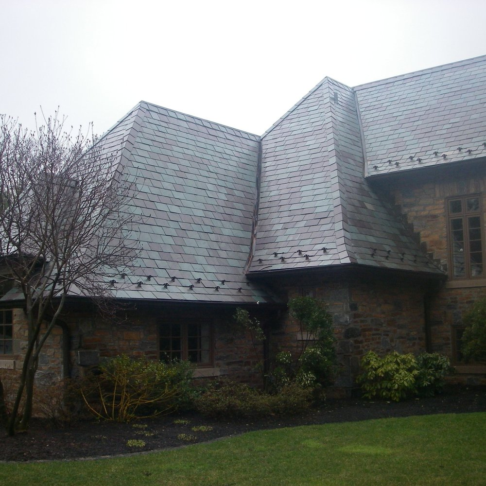 Example of a current residence for which we provide periodic concierge slate and gutter maintenance services.