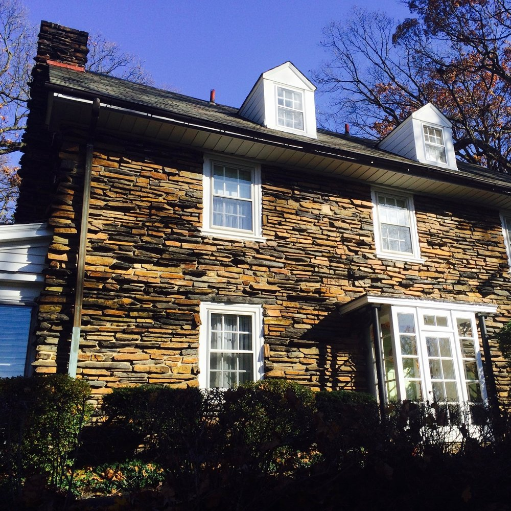 Here's another one of our favorite properties, in Merion. The architecture is very simple but well executed. The protruding courses of variegated sandstone remind us of the bark of a fallen tree. But we can't take credit for such organic stonework. Rather, we replaced the aluminum vent collars, which always leak, with copper ones lined with neoprene rubber. They almost never fail. Simple changes such as these can make a well-built property much more durable.