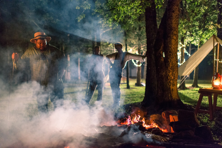 Cooking a meal over a fire, antebellum style. Photo by Andrew Kornylak