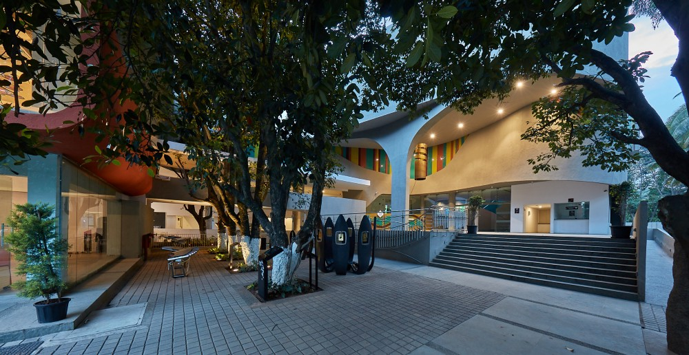 "The entrance to the Indian Music Experience in Bangalore, India. The unusual curved design emerged from a competition open to young architecture practices in Bangalore. ""We invited them to give their vision of how they envisioned a music museum in Bangalore. We told them 'no trees must be cut', so the building waves in and out of the jackfruit and mango trees in the site,"" says museum director Manasi Prasad. All images courtesy of the Indian Music Experience."