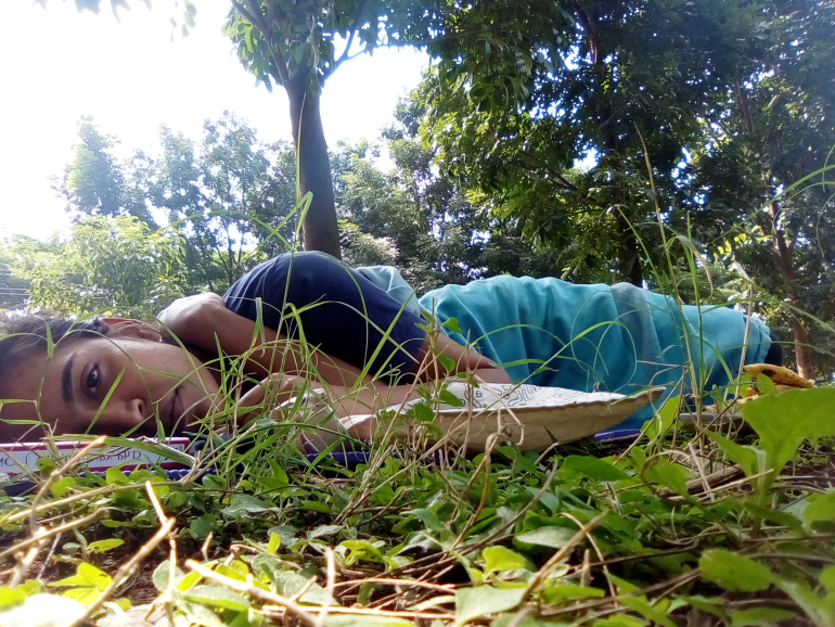 "Pahi Gangwar did a solo Meet To Sleep in 2017. She sent in this text and a photo afterwards: ""I was in the park from 1:15 till 3:30 PM. My heart was pounding as I entered. I picked a spot and eased myself into lying down. Since I was absolutely alone, I took a book and two bananas as my decoy. I put a leaf between the pages and held the book real close to my body and shut my eyes. Every rustle felt like someone had walked up to me, the wind felt like it was blowing away my sheet and shirt and my skin was showing, all the sounds around me were amplified."""