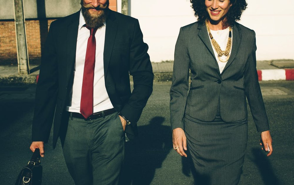 man and woman in business suit communicating