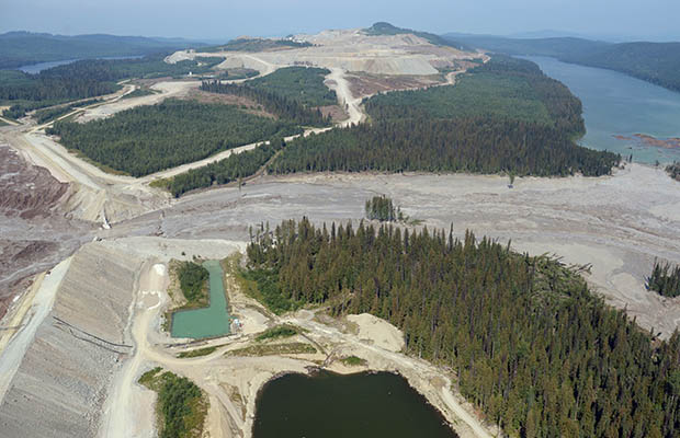 Damage from a tailings pond breach is seen near Likely, B.C., Tuesday, August 5, 2014. A tailings pond that breached Monday, releasing a slurry of contaminated water and mine waste into several central British Columbia waterways, had been growing at an unsustainable rate, an environmental consultant says. THE CANADIAN PRESS/Jonathan Hayward ORG XMIT: JOHV201