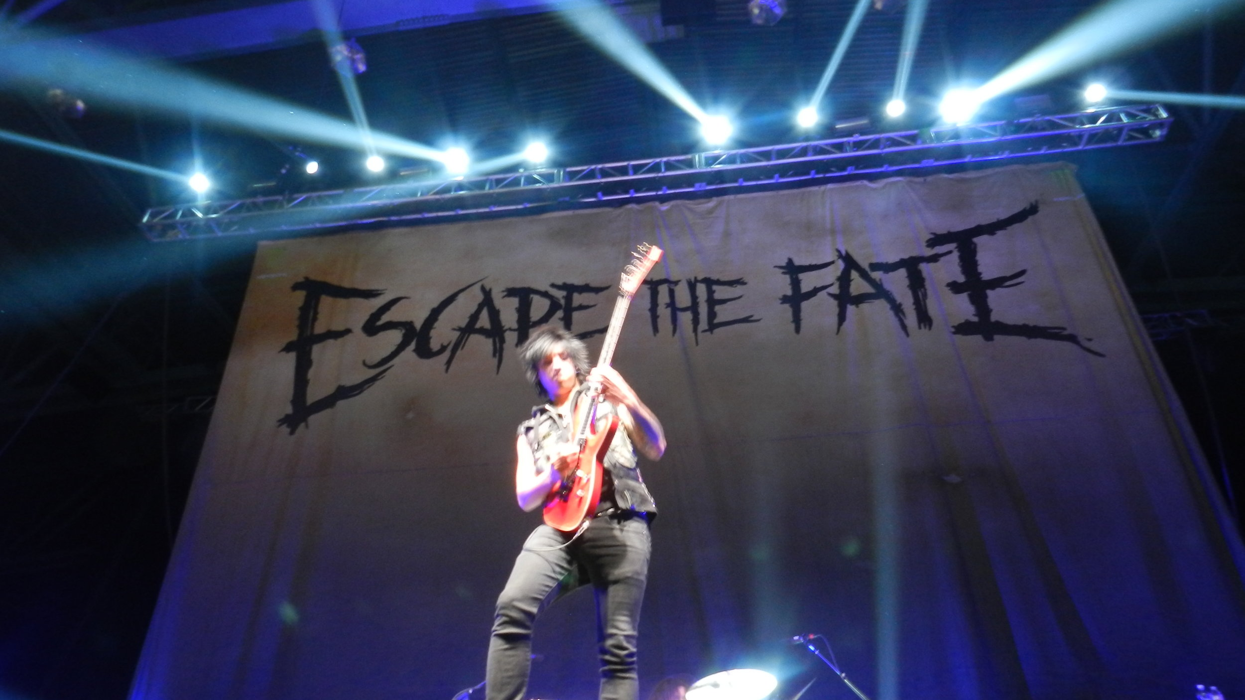 "Bryan ""Monte"" Money of Escape the Fate throws down some licks."