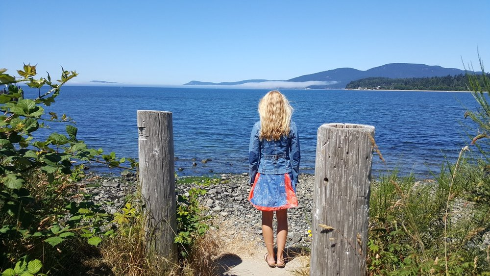 Laura looking out to sea back turned Anacortes.PG
