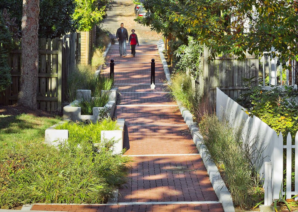 Q Street Green Alley was a first generation green alley in Washington, D.C. led by DDOT. Thomas Rainer served as lead designer and project manager. The project was completed by Rhodeside & Harwell. Photo by Allen Russ.