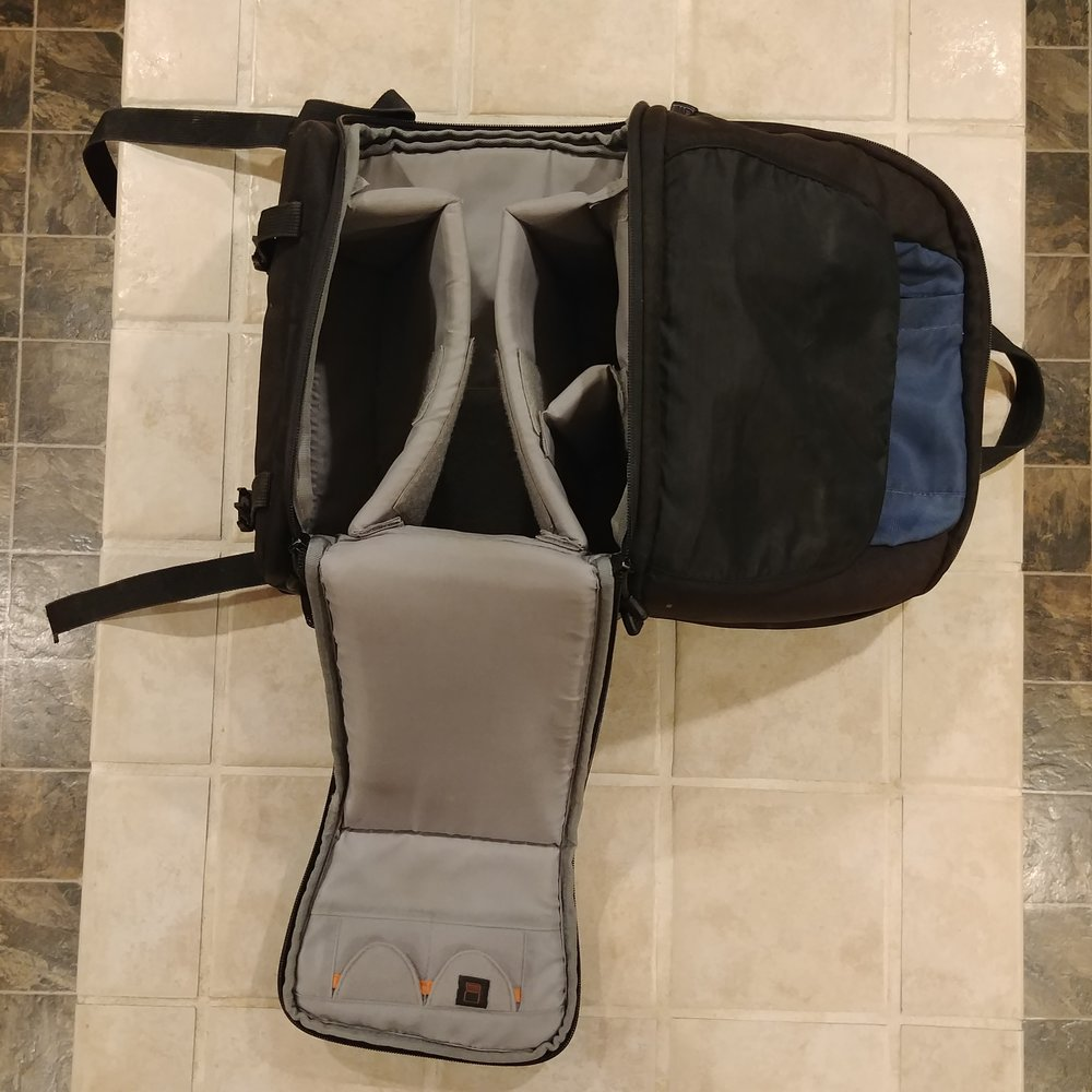 Here is my trusty camera bag with a storage area on top. With kids as travel companions it is quite handy. Even with the flap open is doesn't cover the same amount of 6x6 tiles that my gear does.