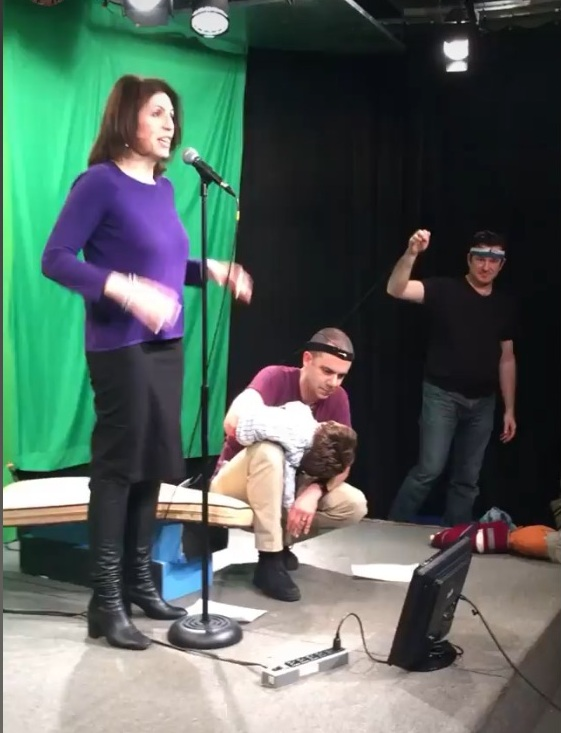 Sharing one of my stories on Monkey News Source with Russian open host, Victor (puppeteer, Paul McGinnis) and Josh Cohen (far right)