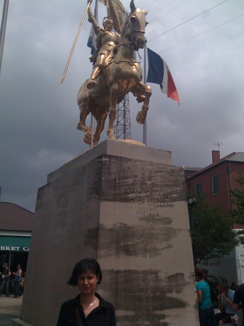 Ruxandra Cesereanu in New Orleans with joan of arc, for the reading at the gold mine saloon of the English-language book