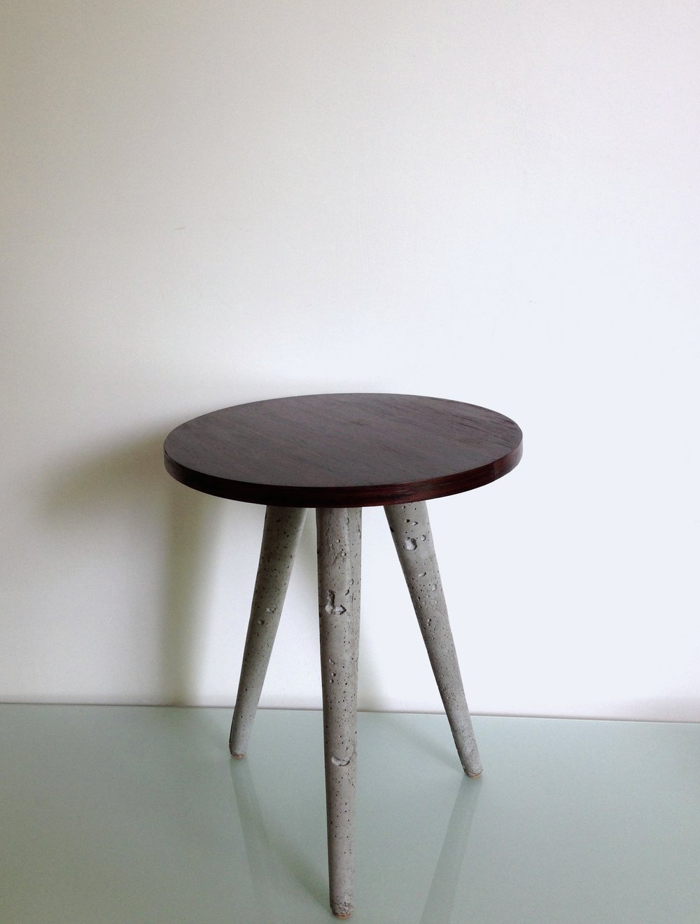 "TA KA TSI KA  rosewood table top, cement legs & steel leg mounts 16"" height x 15"" diameter"