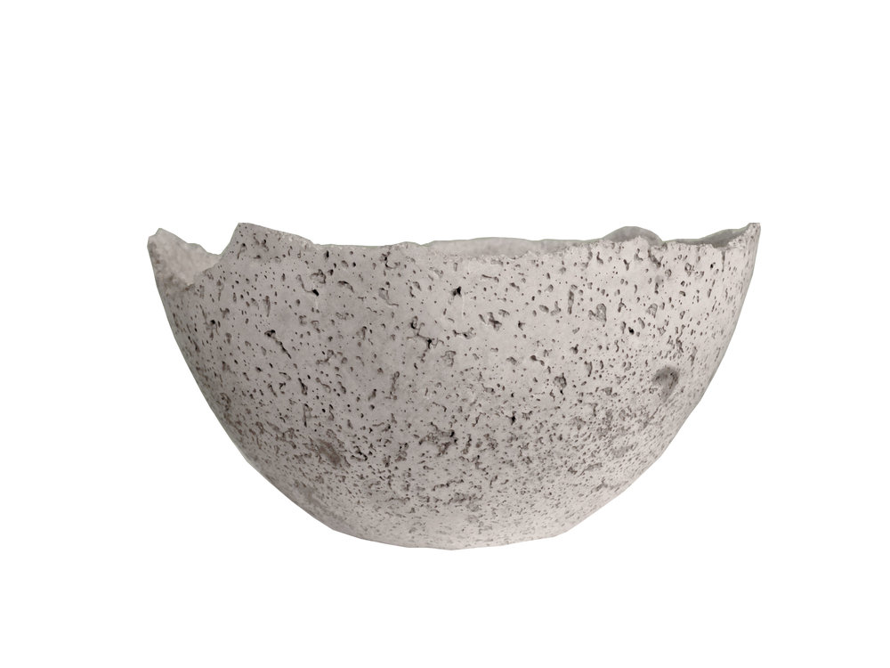 "AYÊ 2   Cement, 4"" H x 9.5-12"" D  These delicate bowls inspired by our popular AYÊ lamp make the perfect centerpiece for your coffee table or dining room table.     * Our bowls, trays and tables are waterproof, food-safe and UV-protected. However, please note that concrete, much like granite and marble, is a very porous material. Cement and concrete will stain if they come into contact with acidic substances such as coffee, lemon juice, mustard or vinegar. Wash with dish soap immediately to avoid permanent staining."