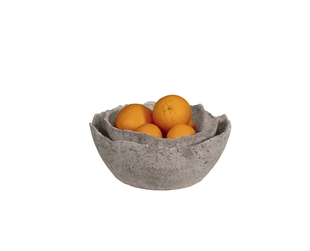 Nestled concrete bowls with oranges