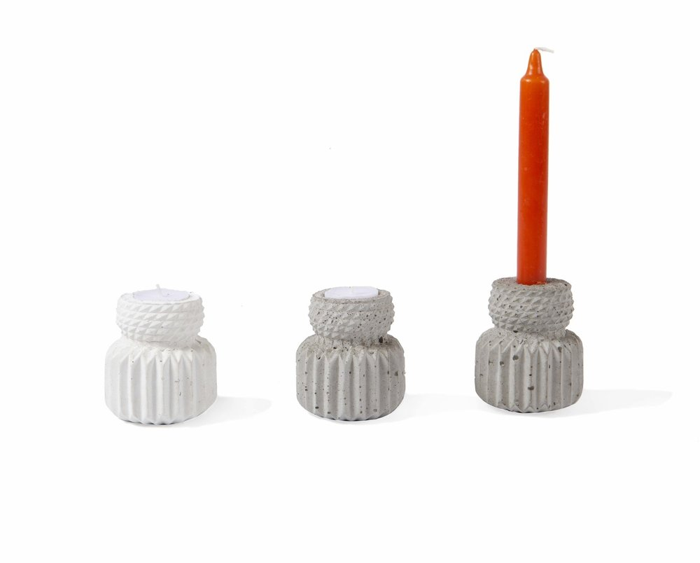 """KIPIK  White or grey concrete, 3.5"""" x 2.5""""  This handmade candle holder comes in grey or white concrete, with the option to fit a tealight or a long taper candle."""