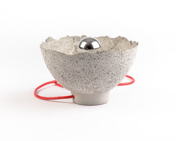 "AYÊ  cement lamp, silver tipped lightbulb, red cord (6"" height x 9.5"" diameter)  Made entirely of 1/4"" thin cement, this LALAYA Design creation brings out the unexpected beauty and delicate nature of the material. Each lamp is one-of-a-kind, varying in texture and thickness. Ayê means earth or physical world in Yoruba. It is a common phrase in Brazilian music usually sung at once fiercely and sweetly, which mirrors the brute strength we have come to expect from cement and the surprising fragility it also harbours."