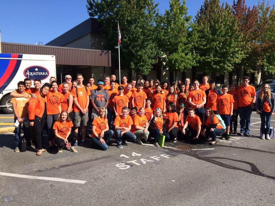Students and staff wearing orange shirt design to promote awareness surrounding residential schools.