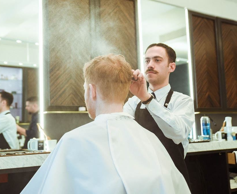 The works - Treat him to a Haircut, Straight Razor Shave, Face Massage, & Scalp Massage.$115 - Price includes tax and tip.