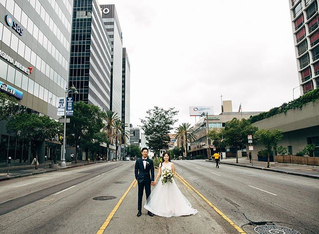 First look 😍😆 of Heather + Joseph's wedding day in the middle of Wilshire Boulvard. They blocked the street for Love Share 5k Run Walk🏃 and it was almost done. We did it in front of the Line hotel.  I love 🙌capturing unexpected moments in wedding photography 💏📸