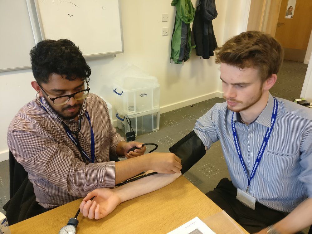 Taking blood pressure using a stethoscope and sphygmanometer