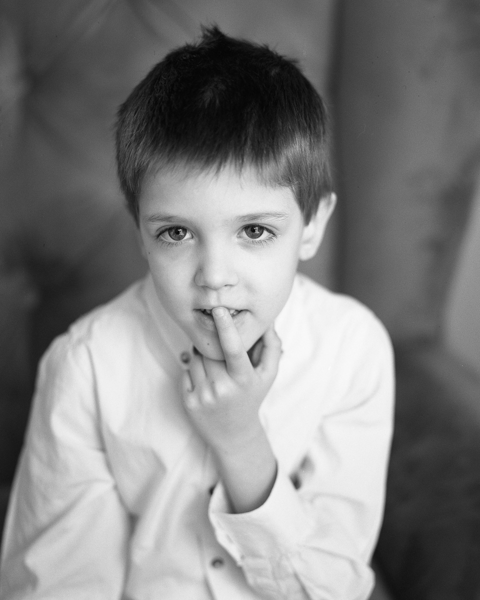 A portrait of my son. Look at the details around the eyes. Ilford Delta 400 was used and PG 100mm F3.5 wide open.