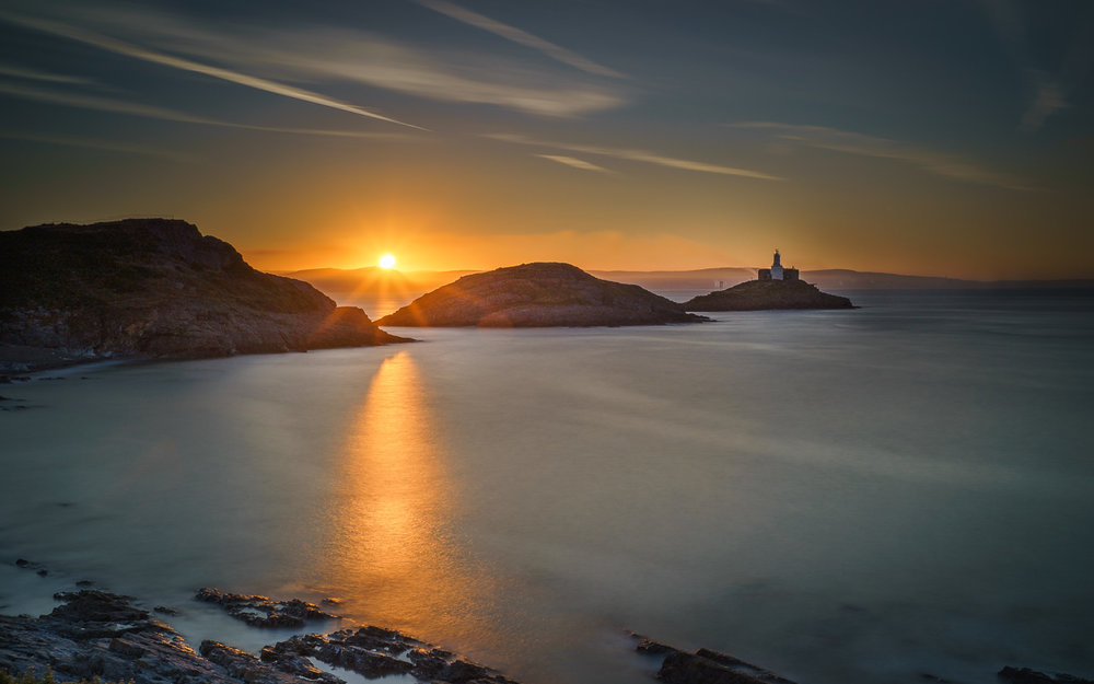 Mumbles Lighthouse At Sunrise