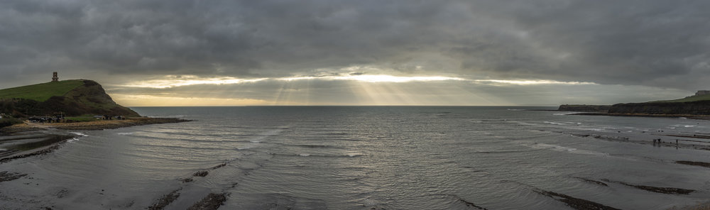 Tyndall effect over Kimmeridge Bay. You can spot a running photo workshop in the bottom right corner. :)