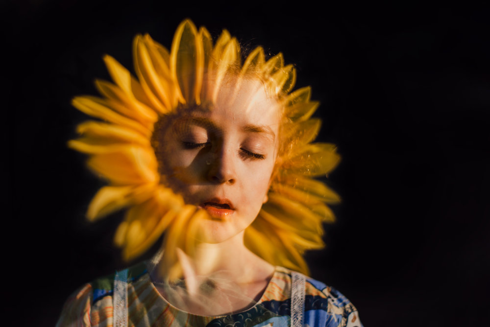 double_exposure_of_girl_and_sunflower.jpg