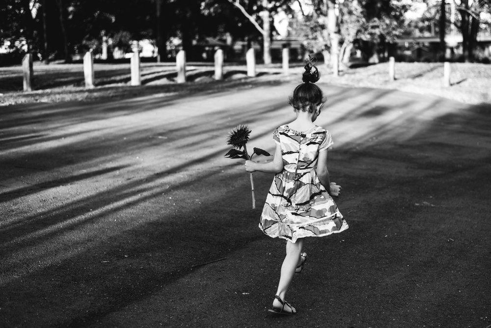girl_skipping_with_flower_in_North_Brisbane.jpg