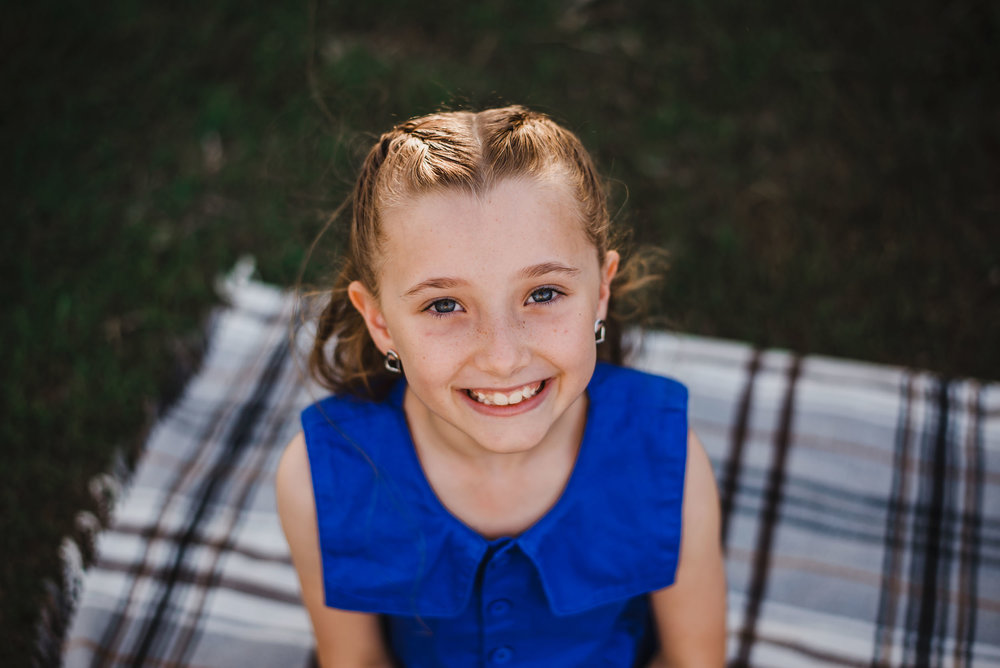 Photograph of smiling girl in blue