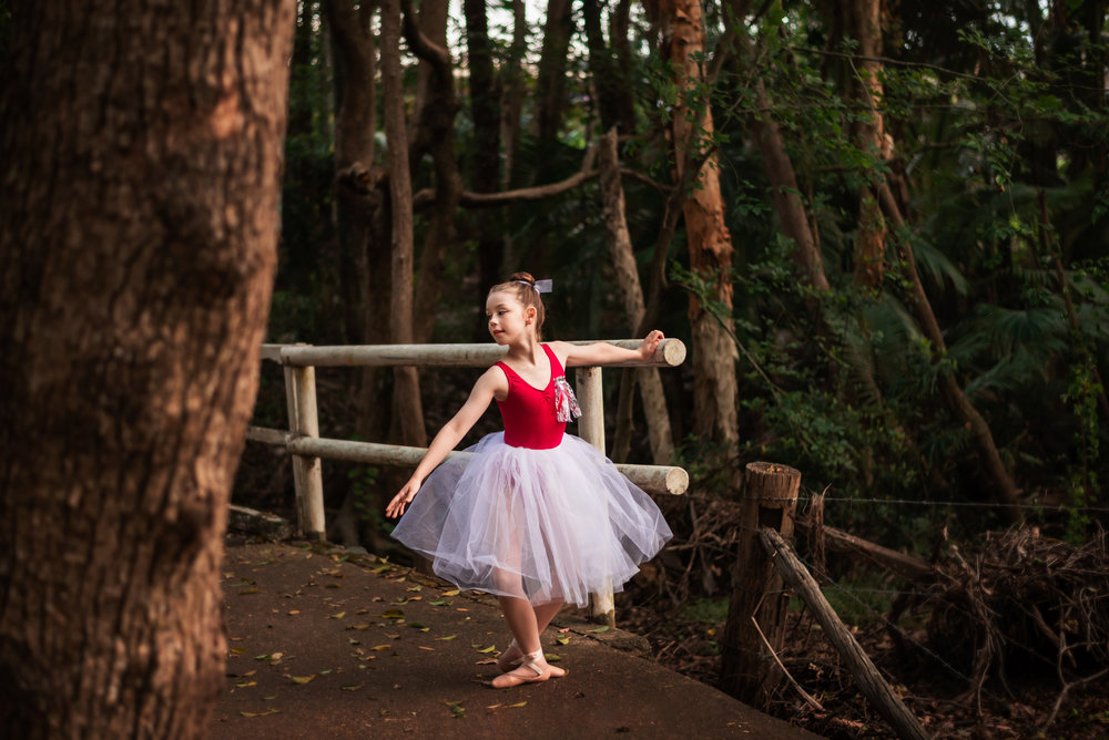 Portrait of a young dancer on a foot bridge