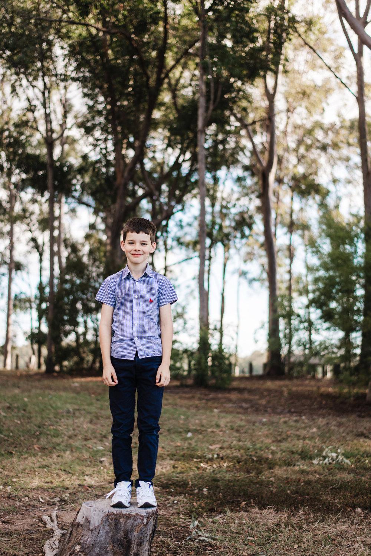 outdoor photograph of boy in bush North of Brisbane