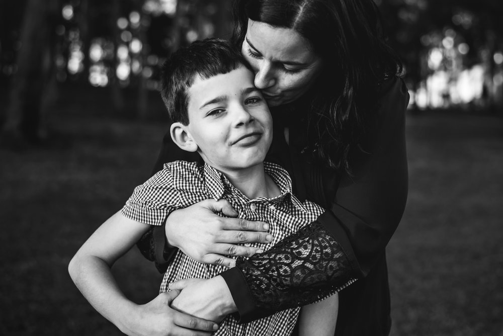 portrait of mum hugging son