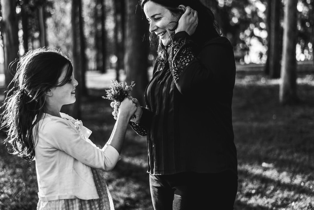 girl giving mum flowers at Lake Samsonvale